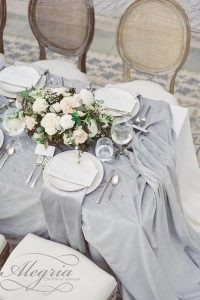 wedding-trends-2019-bridal-table-grey-tablecloth-with-white-flower-centerpiece-laurenfair