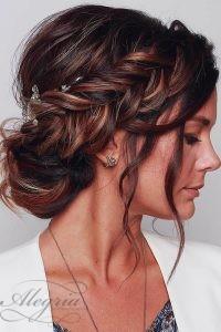 wedding-trends-2019-elegant-royal-bun-with-side-braid-and-loose-curls-blushandmane